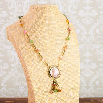 Flower beads and bronze necklace with flower pendant