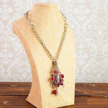 Metal chained necklace with glass beads and feather charms