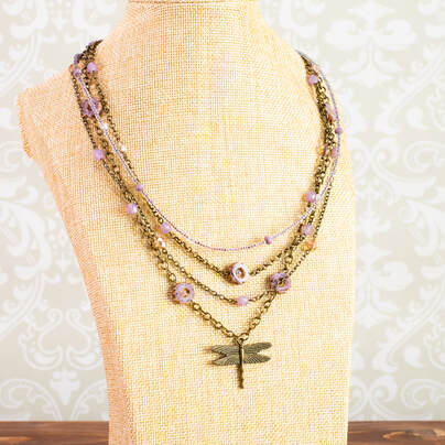 A fun necklace with a cute dragonfly pendant